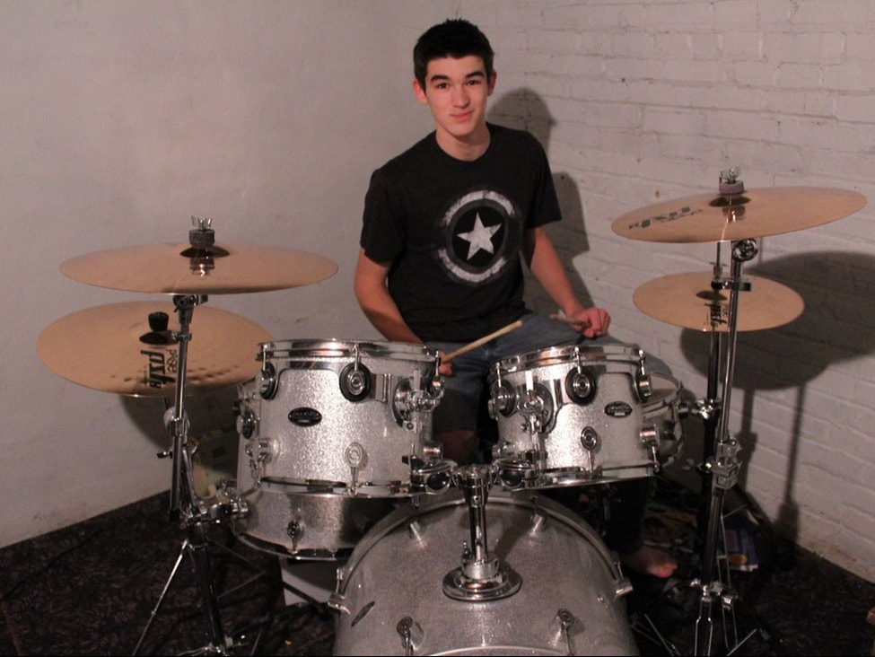 Jacob playing drums